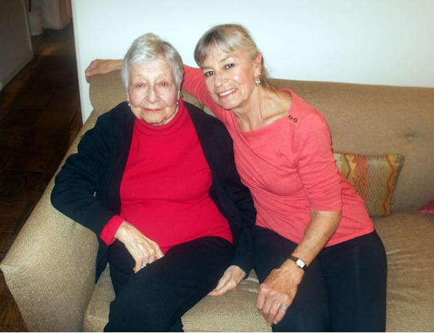In this April 17, 2014 photo provided by the Queens Economic Development Corporation, Rose Vermersch, 95, and her daughter, MariePaule Vermersch, 66, pose for a photo in their home in the Forest Hills