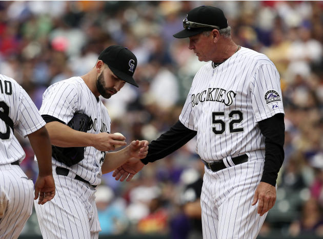Colorado Rockies starting pitcher Tyler Chatwood, left, confers with pitching coach Jim Wright after Chatwood loaded the bases with no outs against the San Francisco Giants in the fifth inning of a ba