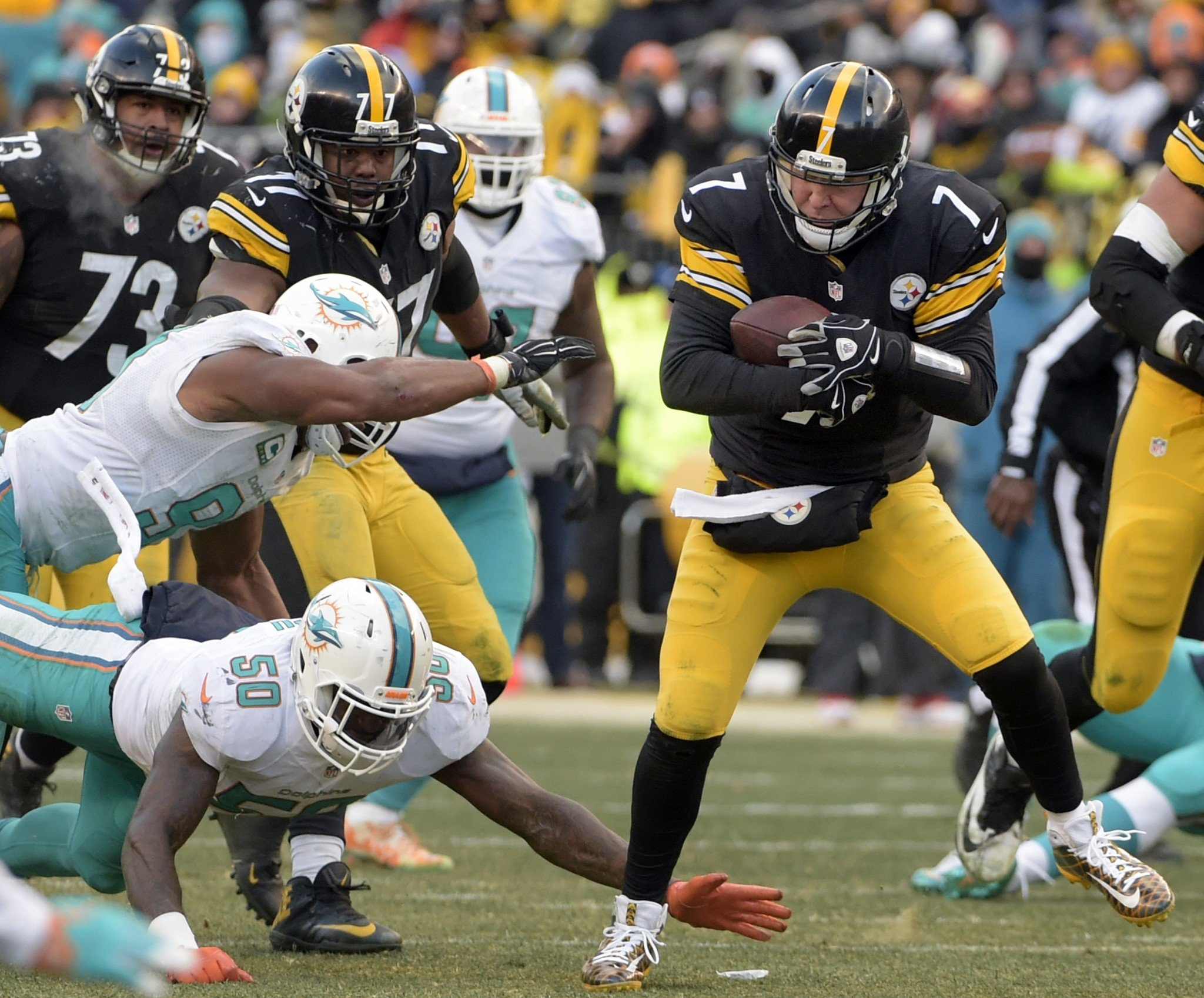 Pittsburgh Steelers QB Ben Roethlisberger hurt his ankle late in Sunday's win. (AP)