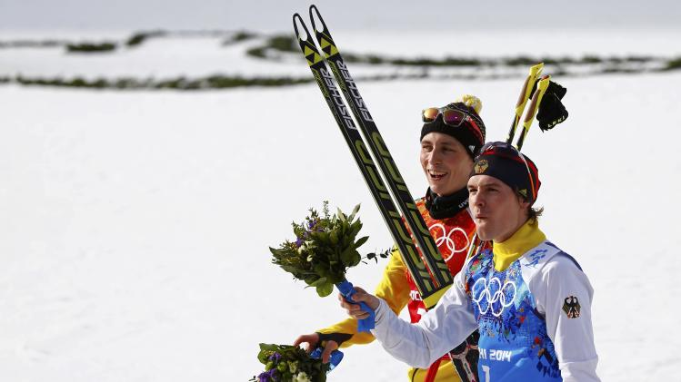 Germany's second-placed team members Frenzel and Riessle celebrate after the flower ceremony for the of the Nordic Combined team Gundersen event of the Sochi 2014 Winter Olympic Games