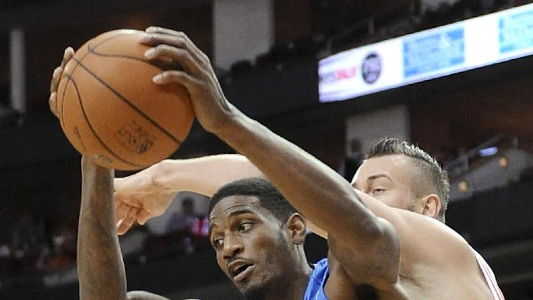 Orlando Magic's Solomon Jones (22) keeps the ball away from Houston Rockets' Donatas Motiejunas in the second half of a preseason NBA  basketball game Wednesday, Oct. 16, 2013, in Houston