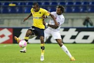 Sochaux' French forward Cedric Bakambu (left) vies with Valenciennes' Brazilian defender Gil during their French L1 match in Montbeliard, March 2012. Bakambu has extended his contract with the Ligue 1 side for two years until June 2015