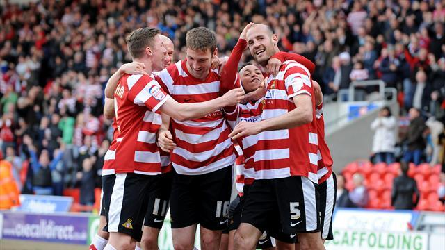 League One - Doncaster remain top, Cherries chase
