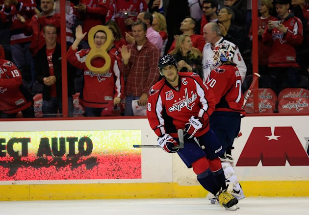 WASHINGTON, DC - NOVEMBER 04:  Alex Ovechkin #8 of the Washington Capitals acknowledges the crowd after scoring an assist against the Calgary Flames in the first period to become the Capitals franchise points leader at Verizon Center on November 4, 2014 in Washington, DC.  (Photo by Rob Carr/Getty Images)
