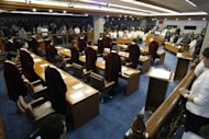 Senators, prosecution and defense panels stand in prayer prior to hearing the oral arguments of both sides in the impeachment trial of Supreme Court Chief Justice Renato Corona in Manilaon. Philippine senators are set to vote Tuesday on whether to sack the nation's top judge after a historic trial over alleged corruption which saw him accused of hiding millions of dollars in assets