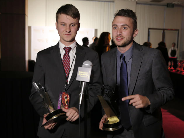"Matt Sloan, left, and Marcus Odom of Southern Illinois University participate in the interview with the award in the Magazine category for ""alt.news 26:46 #1504"" at the 35th College Television Aw"