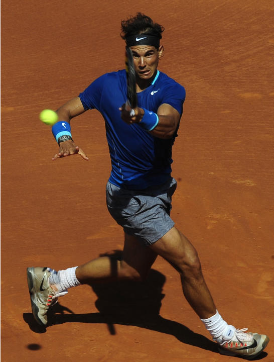 Rafael Nadal returns the ball to Albert Ramos during the Barcelona open tennis in Barcelona, Spain, Wednesday, April 23, 2014. (AP Photo/Manu Fernandez)