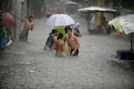 Residents wade through a flooded street after a sudden heavy downpour in Manila in September. More than 152 million people in the Asia-Pacific are now vulnerable to natural disasters every year, up from 24 million in the 1980s, the Asian Development Bank says