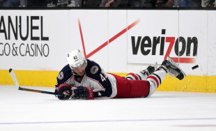 Columbus Blue Jackets center Artem Anisimov, of Russia, dives for the puck during the third period of an NHL hockey game, Sunday, Oct. 26, 2014, in Los Angeles. The Kings won 5-2. (AP Photo/Mark J. Terrill)
