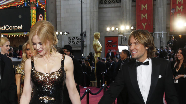 Actress Nicole Kidman, left, and musician Keith Urban arrive at the Oscars at the Dolby Theatre on Sunday Feb. 24, 2013, in Los Angeles. (Photo by Todd Williamson/Invision/AP)