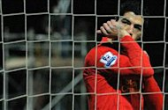 Liverpool striker Suarez admits to diving