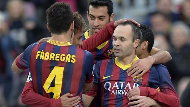 Andres Iniesta celebrates with Barcelona team-mates (AFP)