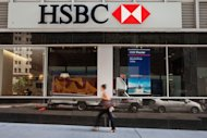 A woman walks past an HSBC Bank branch in New York City. HSBC will slash 30,000 jobs worldwide over the next two years as it looks to slash costs, the global banking giant announced Monday after also unveiling bumper profits