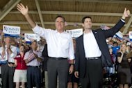 "US Republican presidential candidate Mitt Romney (L) and his running mate Paul Ryan wave at a rally in Manassas, Virginia, on August 11. Romney and Ryan will try to energize supporters in North Carolina Sunday after they hit the road on a bus tour across must-win US states, selling themselves as the duo who can ""save the American dream."""