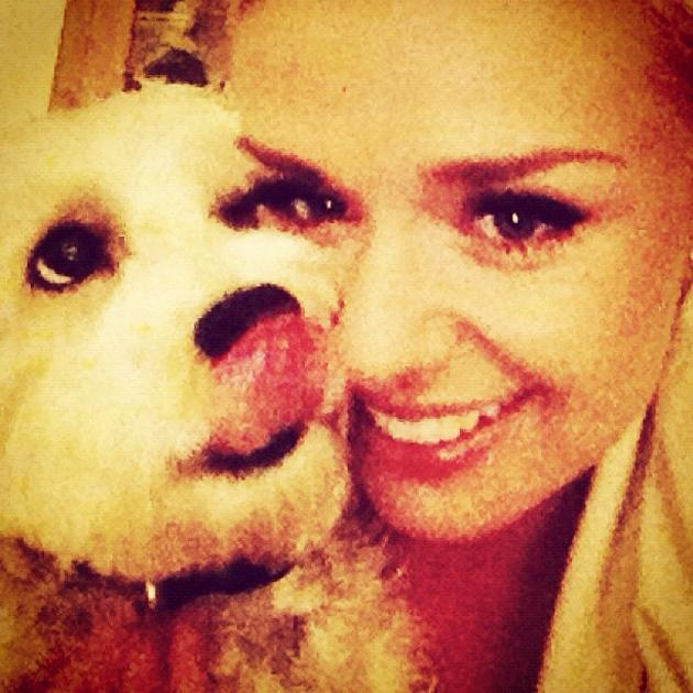 Celebrity pets: Katherine Jenkins tweeted this cute photo of her with her pet dog, Lily. Cute!
