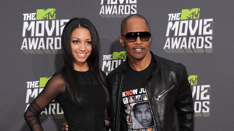 Jamie Foxx, right, and his daughter Corinne Bishop arrive at the MTV Movie Awards in Sony Pictures Studio Lot in Culver City, Calif., on Sunday April 14, 2013. (Photo by Jordan Strauss/Invision/AP)