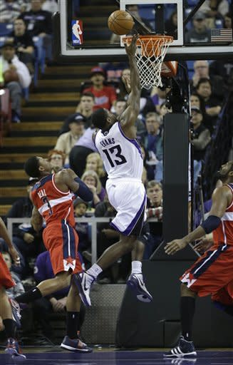Cousins' double-double lifts Kings over Wizards
