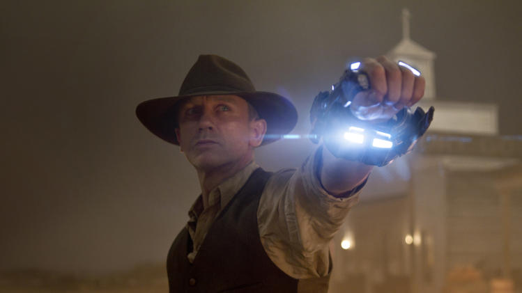 "In this publicity image released by Universal Pictures, Daniel Craig is shown in a scene from ""Cowboys & Aliens."" (AP Photo/Universal Pictures, Timothy White)"