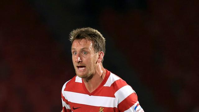League One - Doncaster win five-goal thriller at Scunthorpe