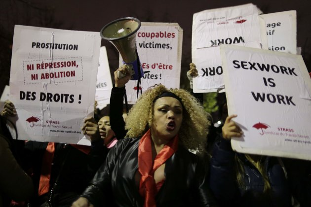 Sex workers attend a protest demonstration in Paris Dec. 4, 2013. (Reuters)