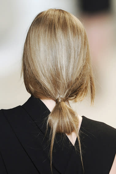 Elie Saab's Fall runway featured low knotted buns that are simple but interesting enough to be…