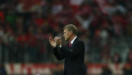 Manchester United's manager Moyes applauds after their Champions League quarter-final second leg soccer match against Bayern Munich in Munich