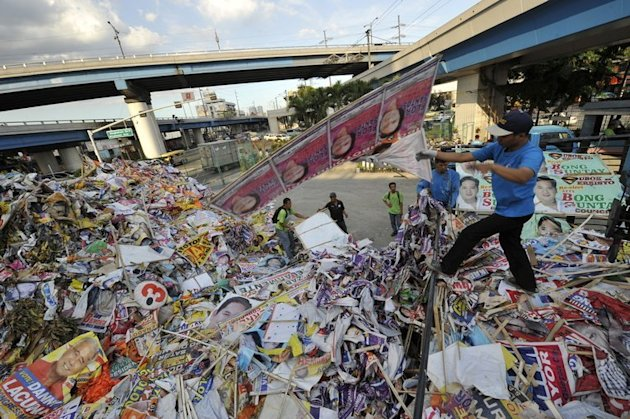 Philippine workers discared election banners and posters at a depot in Manila on May 11, 2010. The Philippines is set to regulate Internet advertising in May mid-term polls as part of an effort to rein in campaign spending, according to election officials