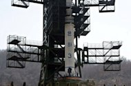 North Korean technicians check the Unha-3 rocket at Tangachai-ri space center. North Korea is hardly known for offering a warm welcome to the world's press, and never before has it given access to a sensitive site featuring its latest space hardware