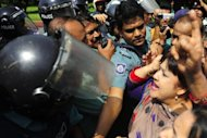Members of parliament from the Bangladesh Nationalist Party clash with riot police during a nationwide strike in Dhaka on Sunday. Police fired rubber bullets and tear gas at hundreds of opposition activists in Bangladesh on Sunday as a nationwide strike over the disappearance of a senior politician brought daily life to a halt
