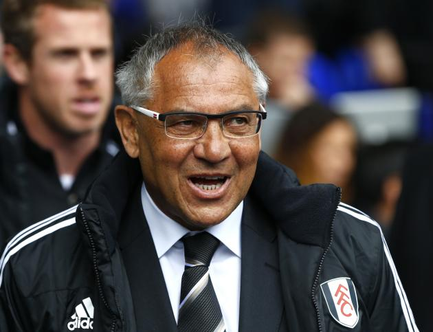 Fulham's manager Magath walks onto the pitch before the start of their English Premier League soccer match against Tottenham Hotspur at White Hart Lane in London