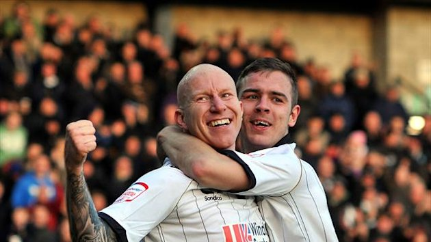 Lee Hughes, left, scored twice on his home debut as Port Vale went top of League Two