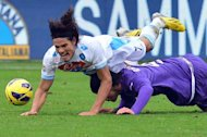 Napoli's Gomez Edinson Roberto Cavani is tackled by Fiorentina's Roncaglia Facundo (R) during their Italian Serie A match at the Artemio Franchi stadium in Florence, on January 20, 2013. Napoli play Lazio next while Fiorentina face Juventus, both fixtures taking place Saturday