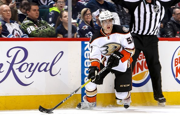 WINNIPEG, MB - MARCH 20: David Perron #57 of the Anaheim Ducks plays the puck down the ice during first period action against the Winnipeg Jets at the MTS Centre on March 20, 2016 in Winnipeg, Manitoba, Canada. The Ducks defeated the Jets 3-2 in overtime. (Photo by Jonathan Kozub/NHLI via Getty Images)