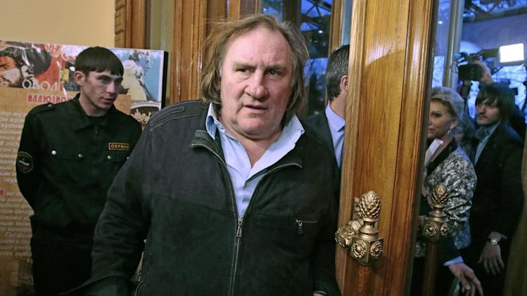 French actor Gerard Depardieu arrives for the opening ceremony of the Illusion movie theater after its restoration in Moscow, Russia, Friday, Feb. 22, 2013. President Vladimir Putin granted Depardieu  Russian citizenship last month and on Saturday he is set to get registered as a resident of the city of Saransk. (AP Photo/Mikhail Metzel)