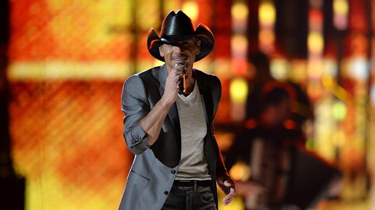 FILE - This April 8, 2013, file photo shows Tim McGraw performs at ACM Presents: Tim McGraw's Superstar Summer Night at the MGM Grand Garden Arena in Las Vegas. Curb Records has sued Tim McGraw and Big Machine Records in federal court, alleging copyright infringement and breach of contract. (Photo by Al Powers/Invision/AP, file)