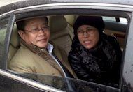 "Liu Xiaobo's wife Liu Xia and lawyer Mo Shaoping arrive at the trial of her brother Liu Hui in Beijing on April 23. A Chinese court Friday upheld an 11-year prison sentence given to a relative of jailed Nobel laureate Liu Xiaobo, a lawyer said, in a verdict the family claimed was littered with ""lies"""