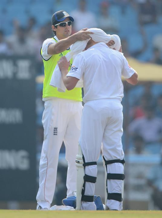 England 12th man Alastair Cook with Jonathan Bairstow during day one of the tour match between Mumbai A and England at The Dr D.Y. Palit Sports Stadium on November 3, 2012 in Mumbai, India. (Photo by
