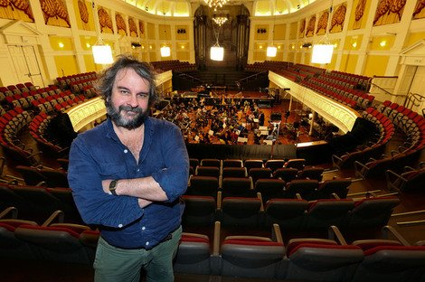 Peter Jackson in the Wellington Town Hall with the New Zealand Symphony Orchestra behind him recording the soundtrack for 'the Hobbit Desolation of Smaug'