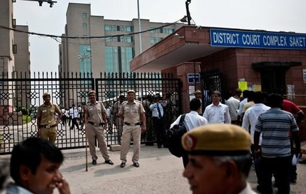 Police stand guard outside the Saket Court Complex in New Delhi on September 13, 2013. A judge has sentenced four men to death for the fatal gang rape of an Indian student on a bus last December, triggering applause inside the packed courtroom