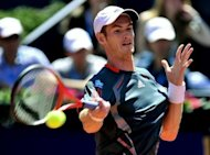 Britain's Andy Murray returns the ball to Colombian Santiago Giraldo during their match of the Barcelona Open tournament Conde de Godo in Barcelona, April 2012. Murray has pulled out of the Madrid Open with a back injury