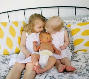5 Ways to Get Siblings Involved with Baby
