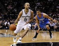 San Antonio Spurs' Tony Parker (L) and Oklahoma City Thunder's Thabo Sefolosha during game two of their Western Conference Finals on May 29. The Spurs defeating Oklahoma 120-111 to seize command of their NBA playoff series