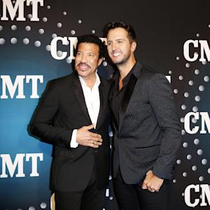 "Lionel Richie and Luke Bryan pose on the red carpet at the CMT ""Artists of the Year"" event at Bridgestone Arena, on Tuesday, December 3, 2013, in Nashville, Tenn. (Photo by Donn Jones/Invision/AP)"