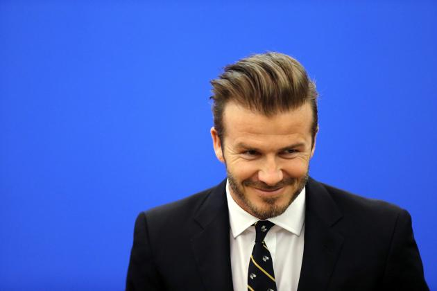 Former captain of England soccer team David Beckham arrives at a ceremony at the Great Hall of the People in Beijing