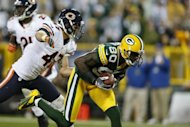 Donald Driver of the Green Bay Packers catches a 26-yard touchdown pass behind Chris Conte of the Chicago Bears during the second half of the game at Lambeau Field on September 13 in Green Bay, Wisconsin. The packers won 23-10