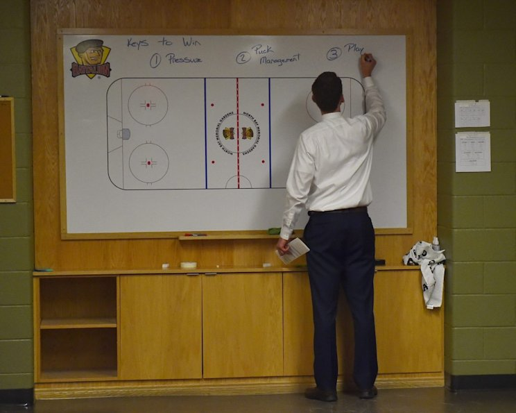 Erie Otters head coach Kris Knoblauch writes on the board before the Canada-Russia Series.