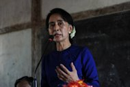 Myanmar opposition leader Aung San Suu Kyi speaks to villagers near a Chinese-backed copper mine project in Monywa, northern Myanmar on March 13, 2013. Members of Myanmar's Muslim minority Rohingya community said Thursday they have been barred from a gathering to welcome democracy hero Aung San Suu Kyi when she visits Japan.
