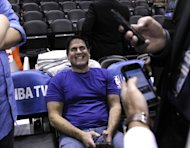 SAN ANTONIO, TX - APRIL 23: Mark Cuban owner of the Dallas Mavericks waits for a reaction from reporters after sending a tweet before his team plays the San Antonio Spurs in Game Two of the Western Conference Quarterfinals during the 2014 NBA Playoffs at the AT&T Center on April 23, 2014 in San Antonio, Texas. NOTE TO USER: User expressly acknowledges and agrees that, by downloading and/or using this photograph, user is consenting to the terms and conditions of the Getty Images License Agreement. (Photo by Chris Covatta/Getty Images)
