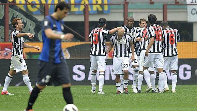 Siena's players congratulate their teammate Simone Vergassola after he scored against Inter Milan