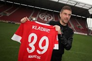 Croatian forward Ivan Klasnic poses with his jersey of the Bundesliga first division soccer club Mainz in southern Germany